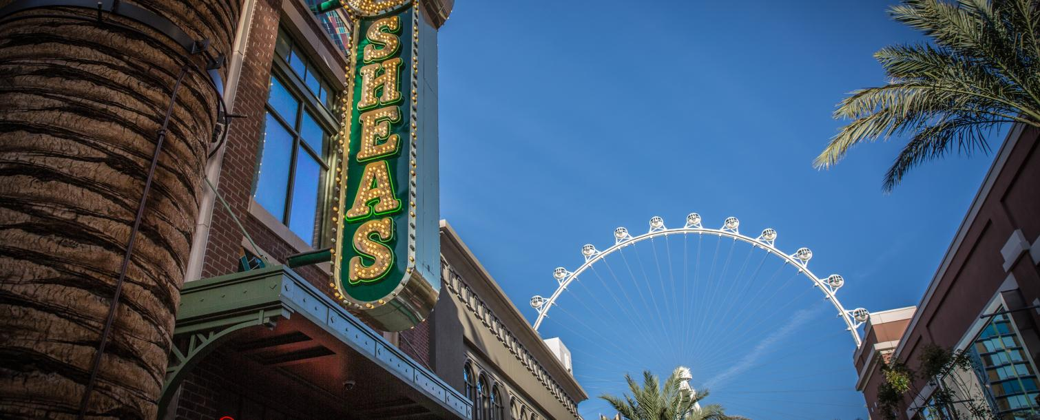 Sign for O'Sheas Casino with the High Roller Ferris Wheel in the background