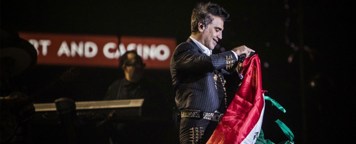 Alejandro Fernandez holding Mexican flag