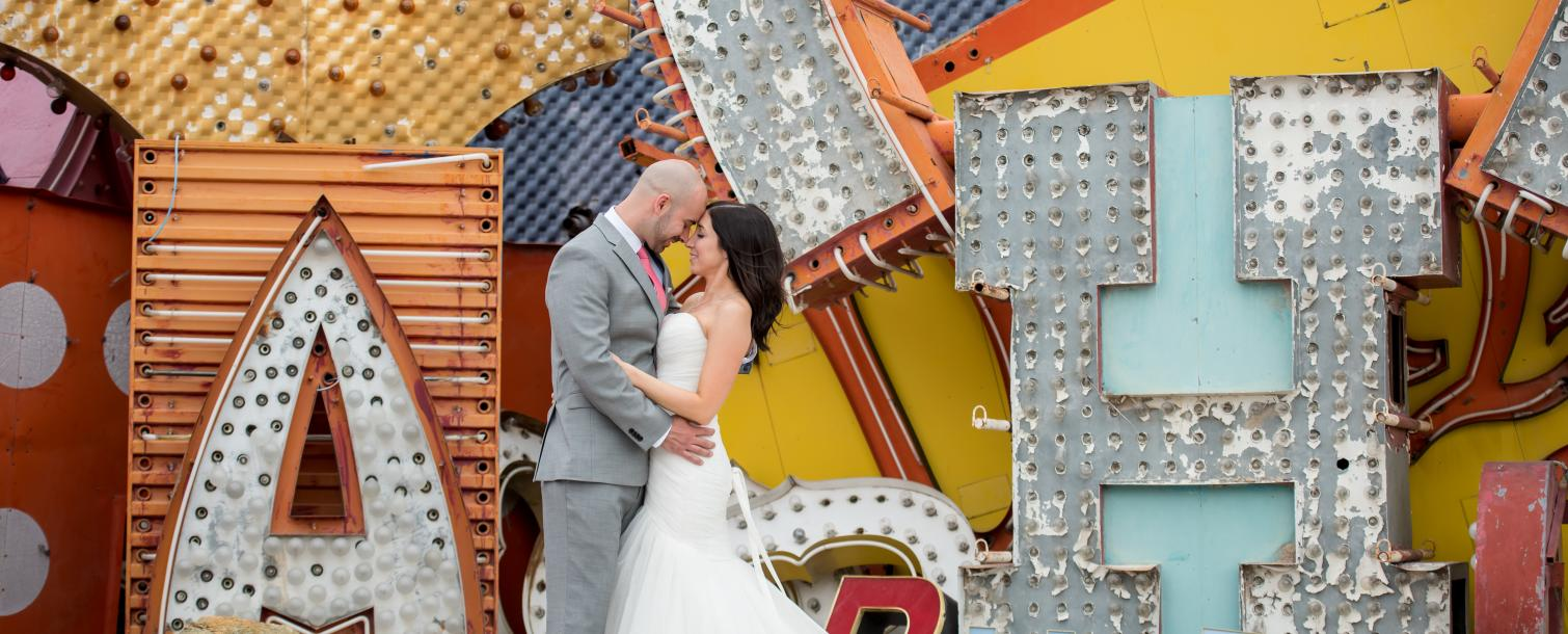 wedding couple at the Neon Museum