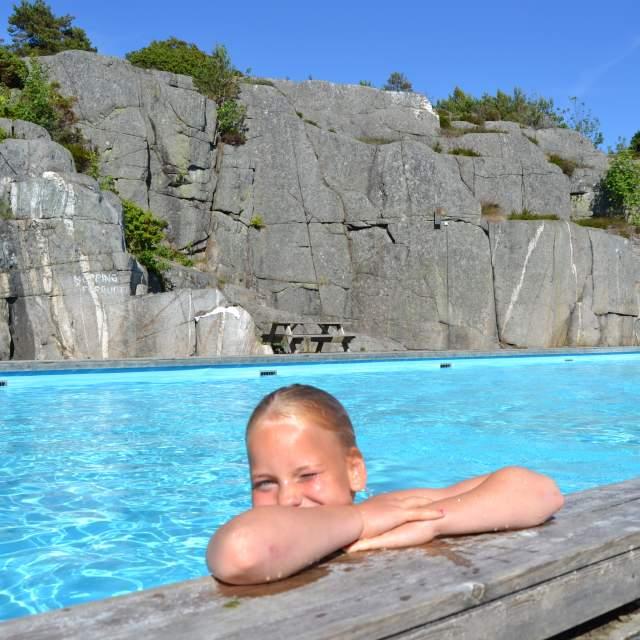 Happy kid in pool at Skottevik camping near Kristiansand