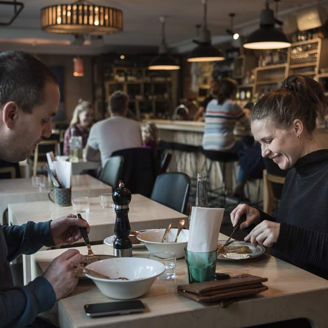 Two people having lunch at Smalhans restaurant, Oslo, Eastern Norway