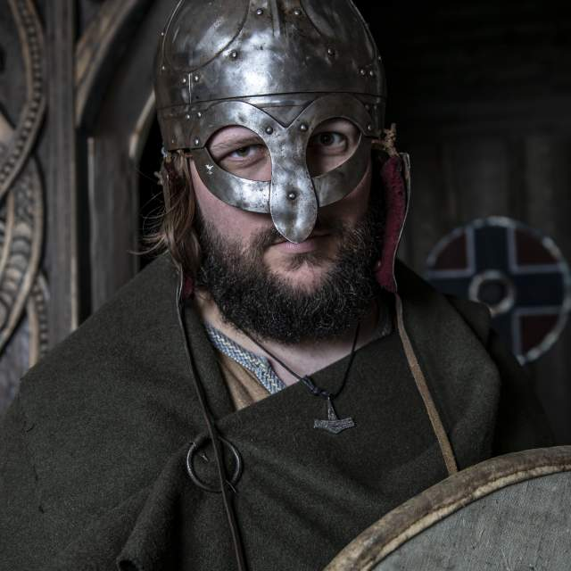 A Norwegian Viking with helmet and shield