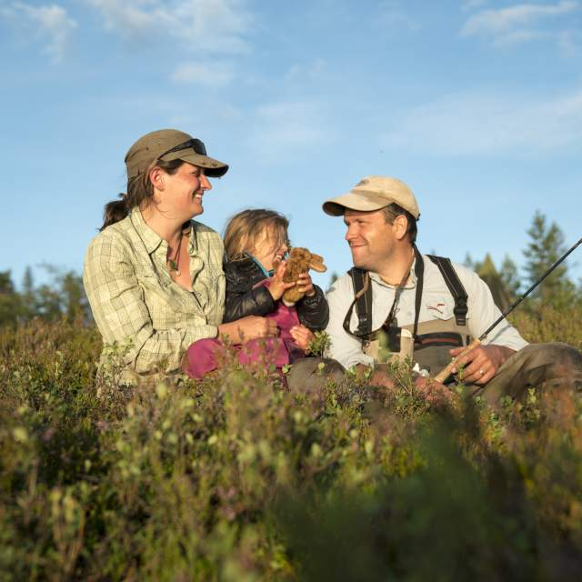A family of three is fishing in the Blefjell mountain area.