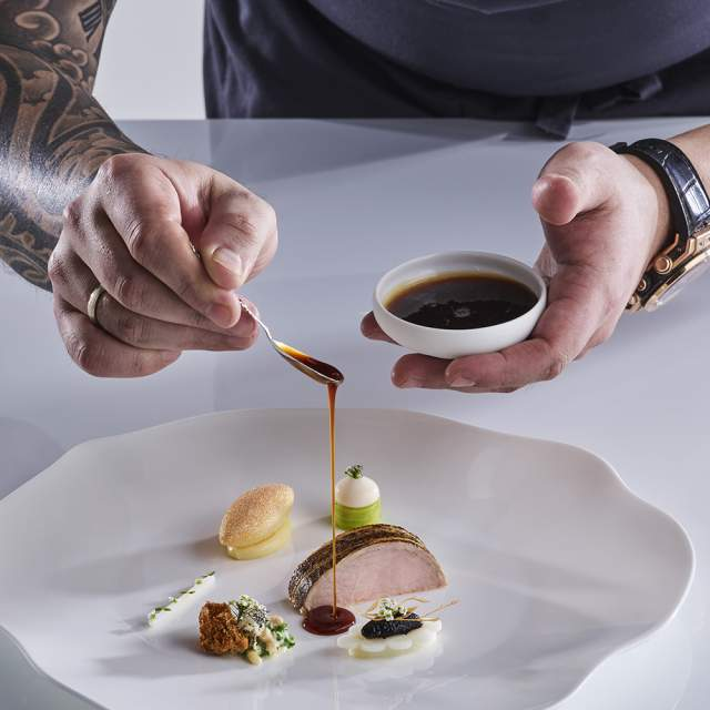 Norwegian chef Christian André Pettersen arranging food on a plate in Bocuse d'Or 2019