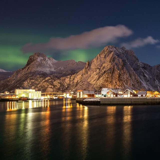 The Northern Lights over Svinøya on the Lofoten islands in Northern Norway