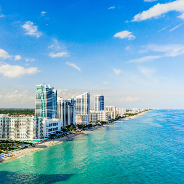 Aerial view of Hallandale Beach and buildings at the shoreline