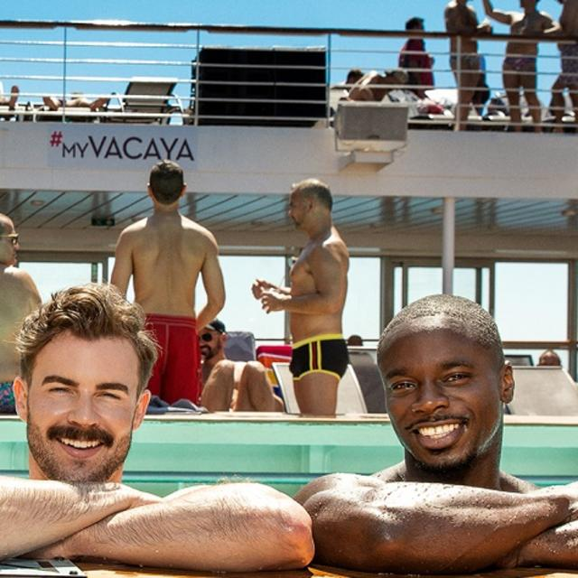 Four handsome men in a pool on board a cruise ship, smiling