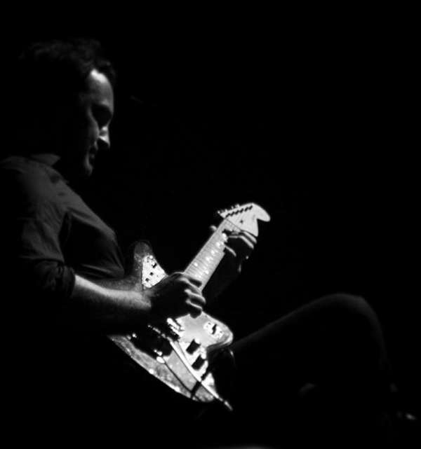 Joel Savoy Plays Guitar