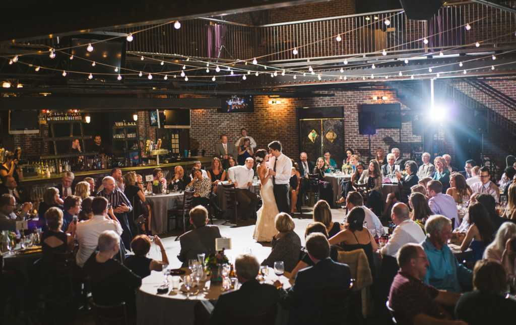 Newlyweds Dancing At A Wedding Mile High Station In Denver Colorado