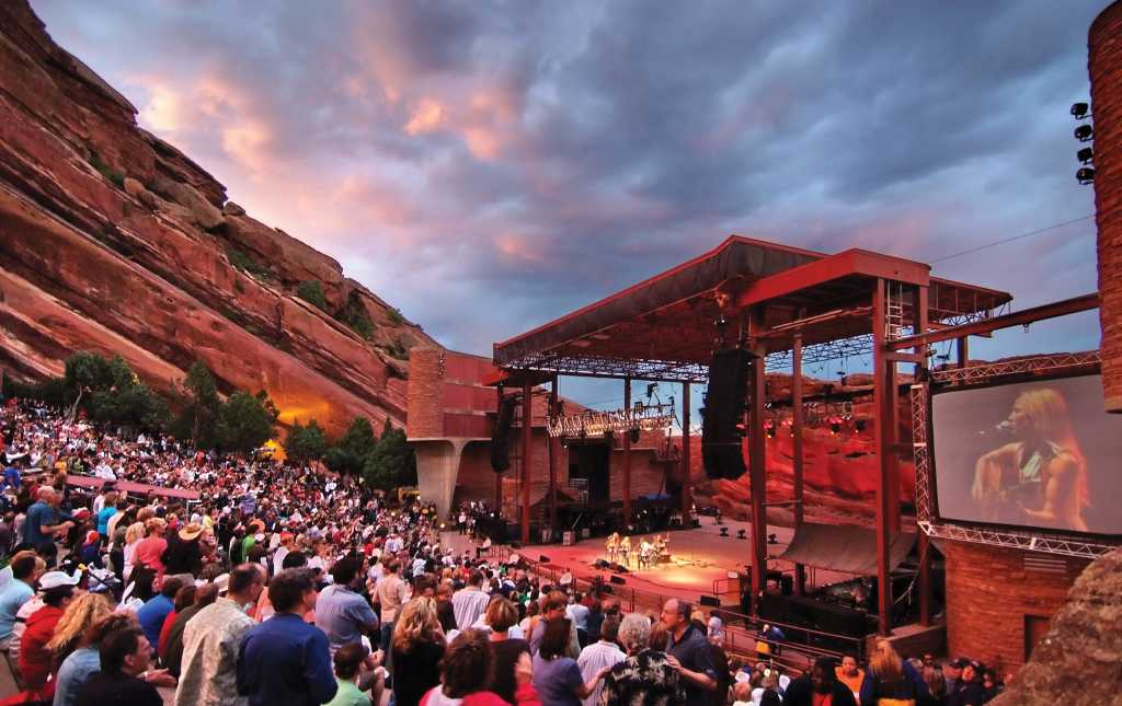 Concertgoers Enjoying An Evening Of Live Entertainment At Red Rocks Park Amphitheater