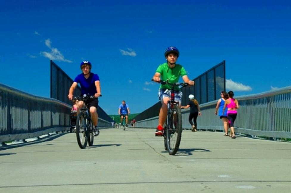 Bicyclists cruising across the walkway over the Hudson River