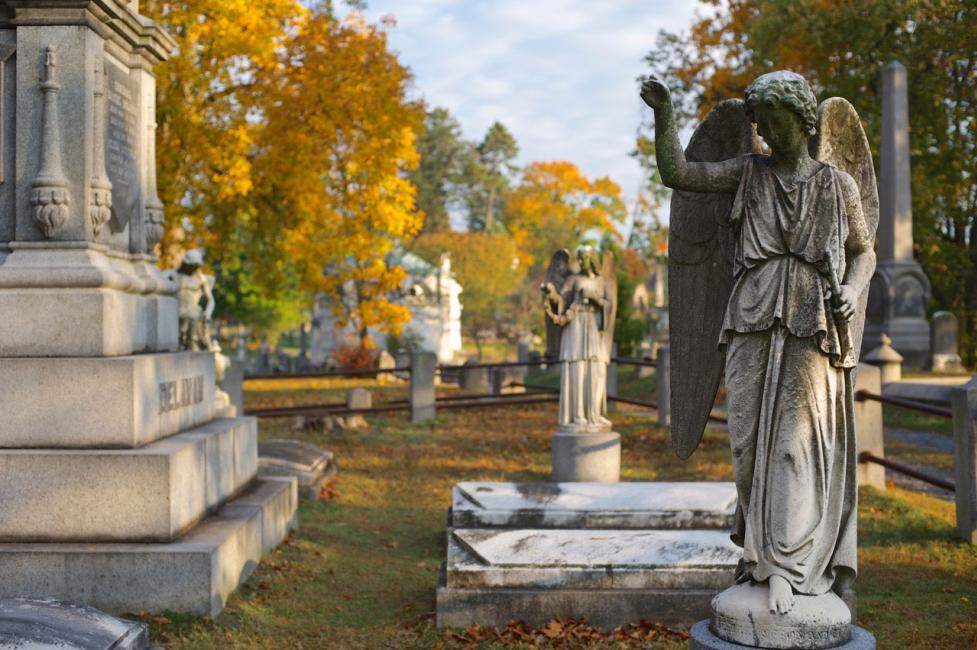Stone gravestones and angels at Sleepy Hollow Cemetery