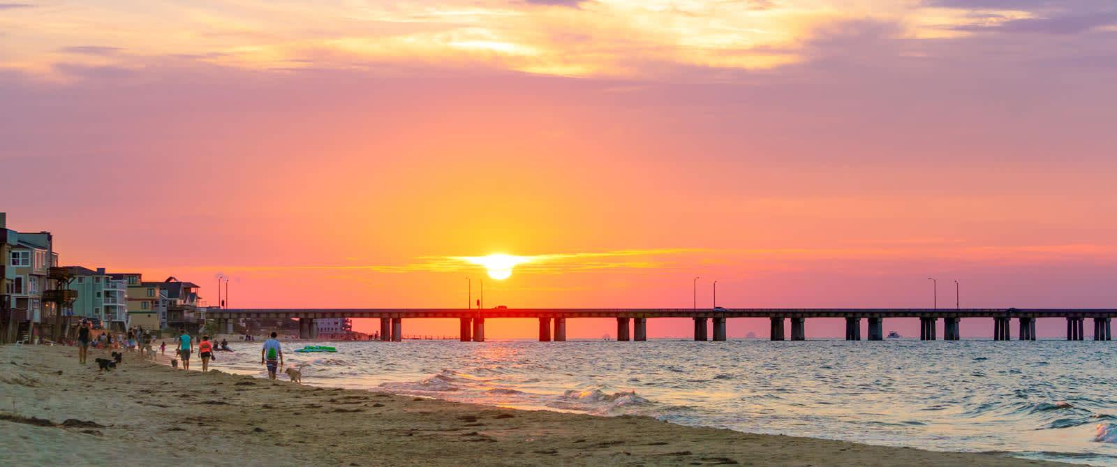 bigstock-Sundown-At-The-Beach-95818136