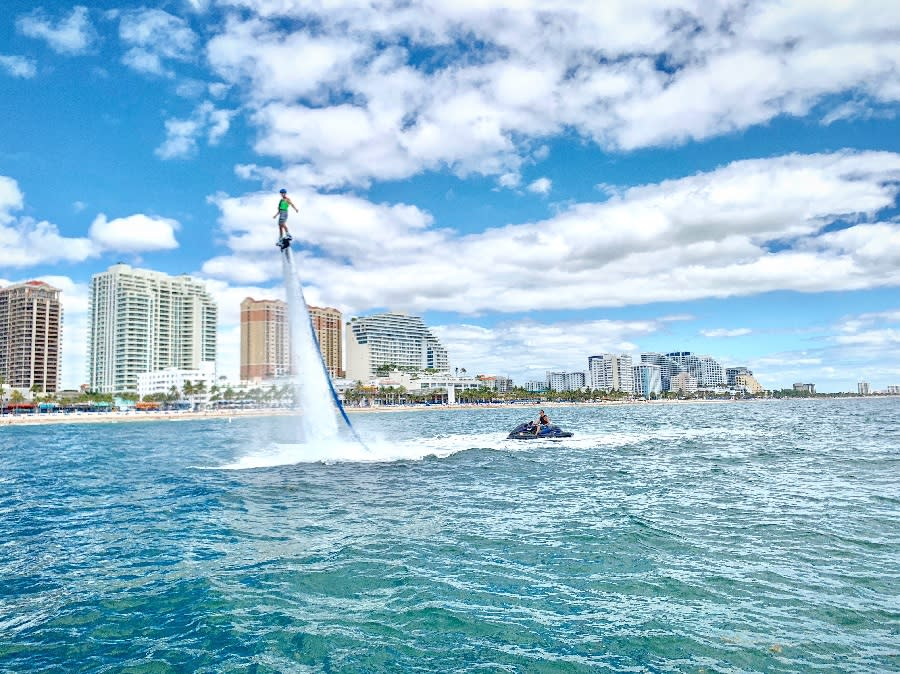 Person using a fly board in the waters of Fort Lauderdale