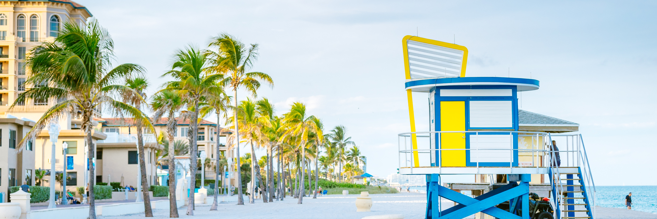 A brightly-colored lifeguard stand watches over the white sands of Hollywood Florida
