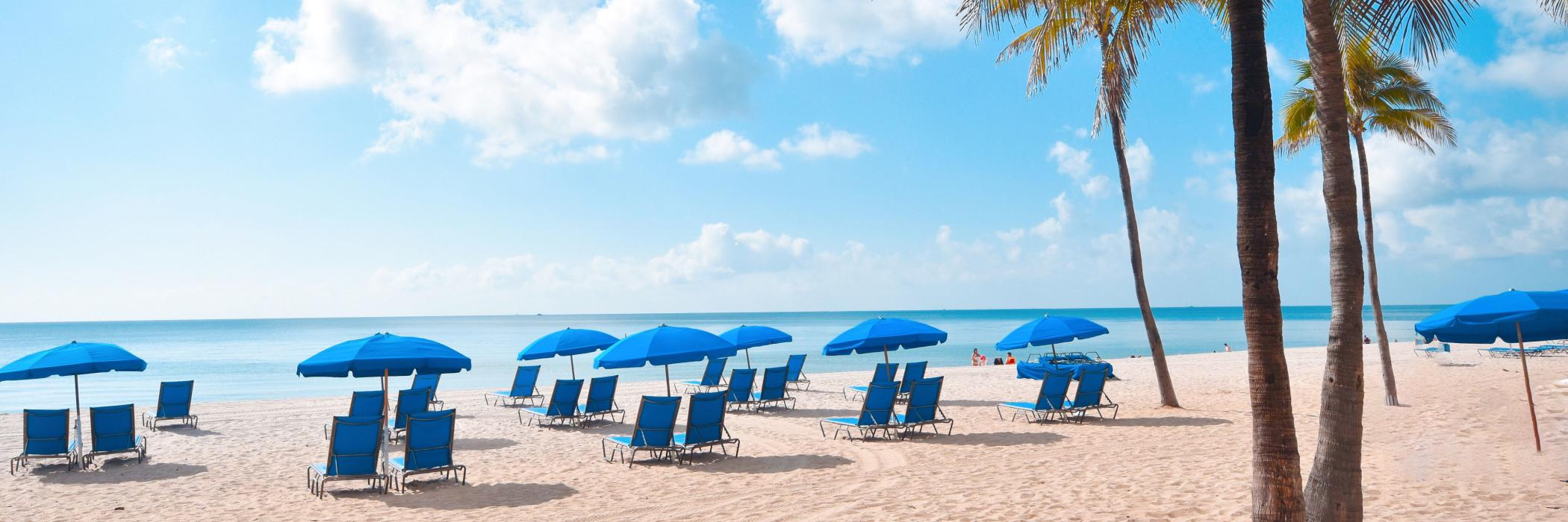 Blue chairs and umbrellas on the beach in Fort Lauderdale