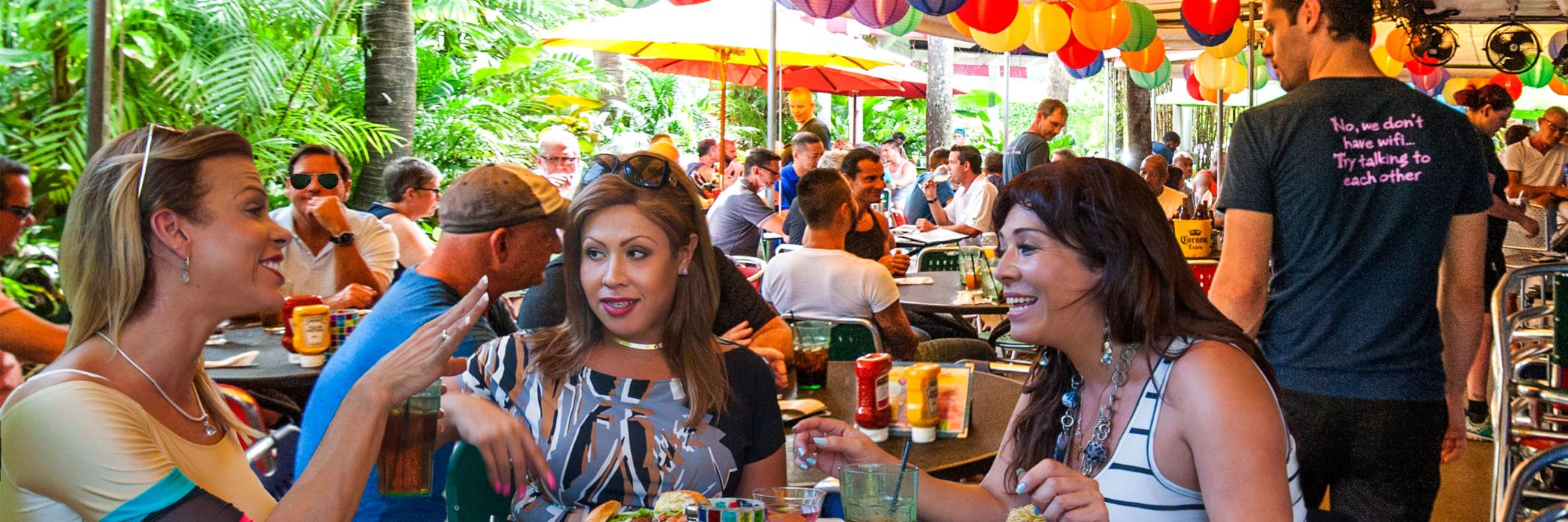 Transgender women enjoy a meal at Rosie's Bar & Grill in Wilton Manors, FL