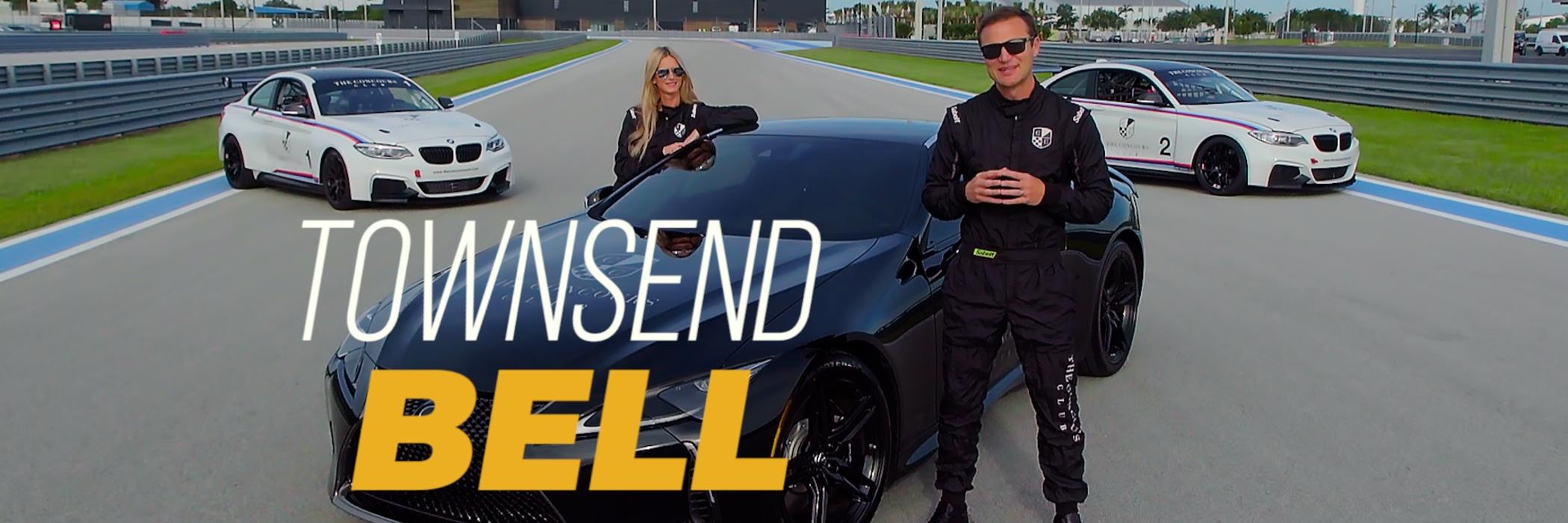 Townsend Bell and friend with luxury car