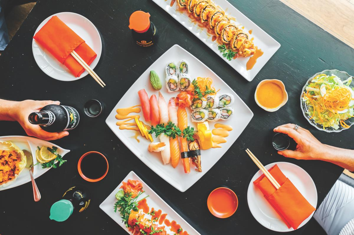 The top view of a table full of a selection of sushi dishes