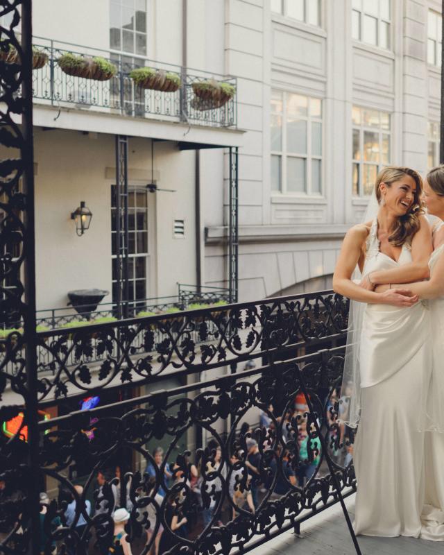 LGBT brides on balcony