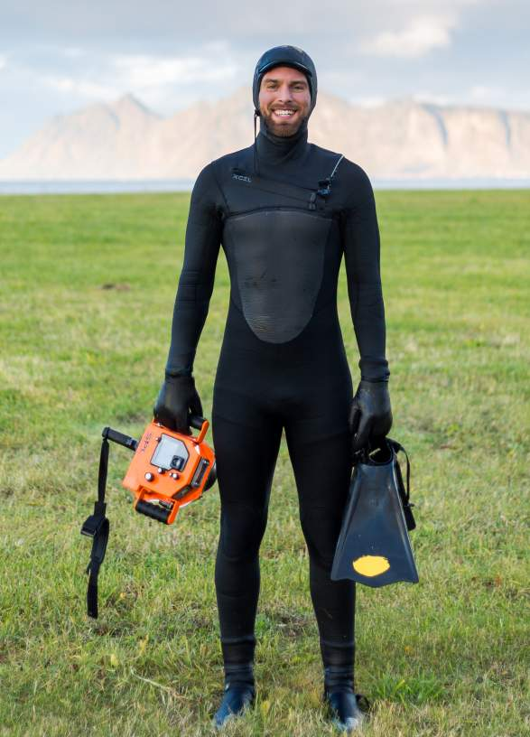 The surfer Hallvard Kolltveit in a wetsuit, Norway