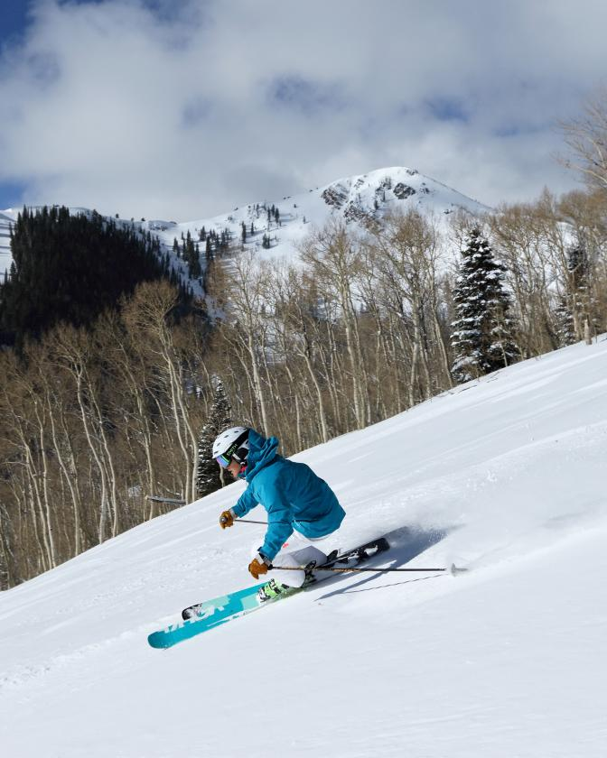 Woman Skiing Groomed Run