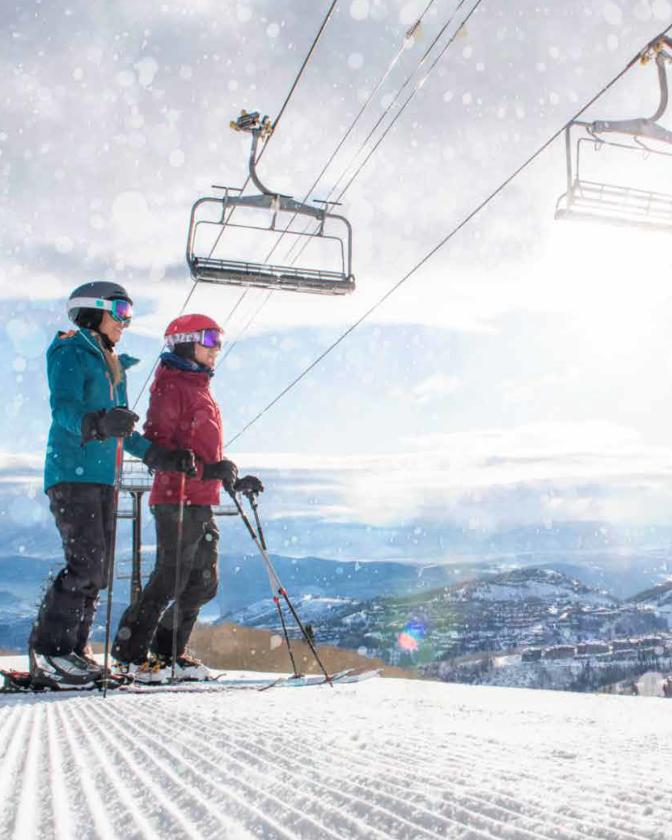 Winter's Favorite Town Skiers on Groomer