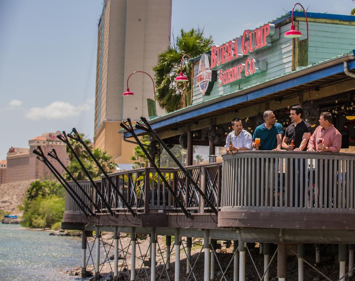 Men having beers on balcony at Bubba Gump Shrimp Co. in Laughlin