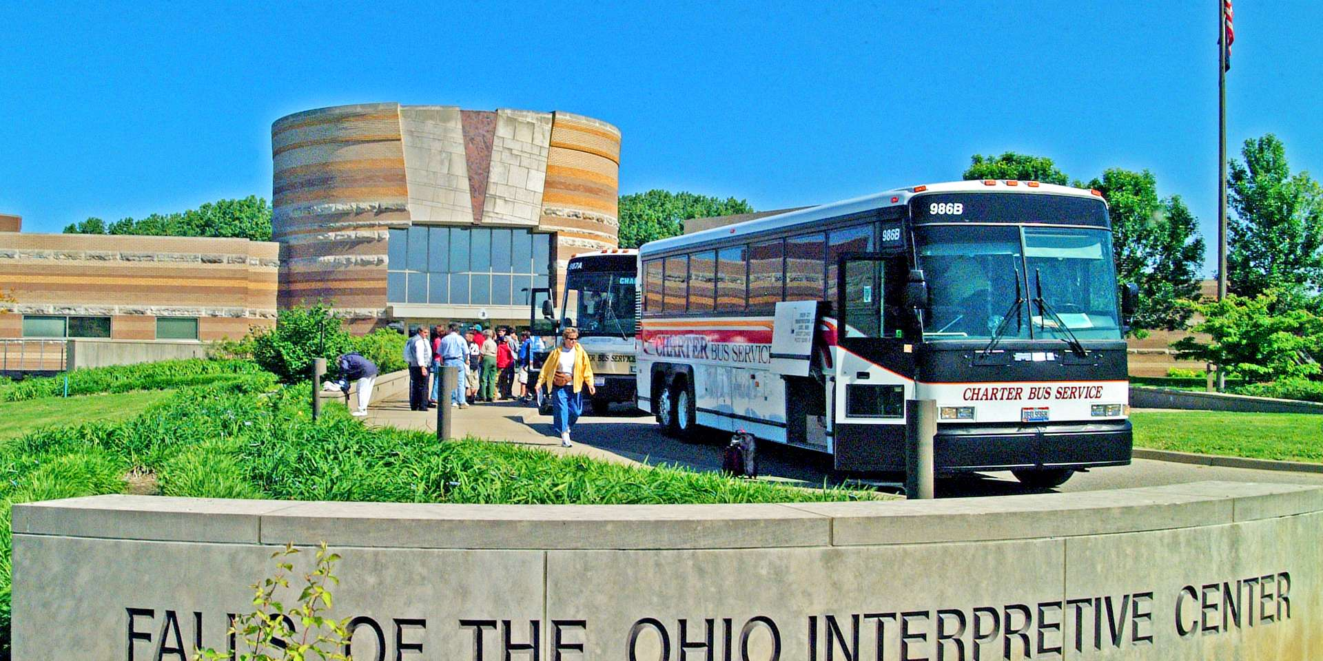 Tour buses at the Falls of the Ohio State Park