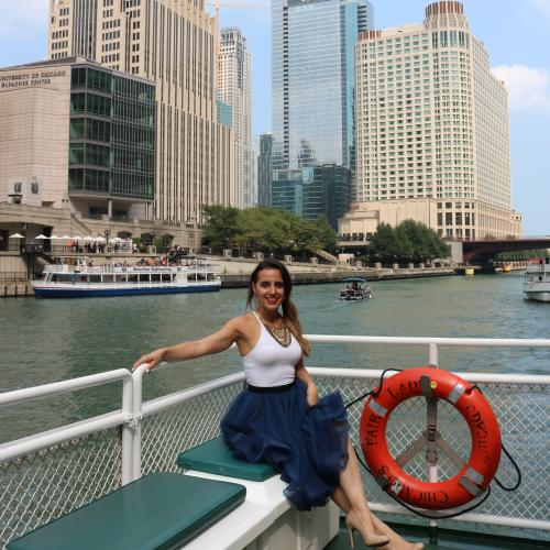Influener poses along chicago River aboard Chicago's First Lady
