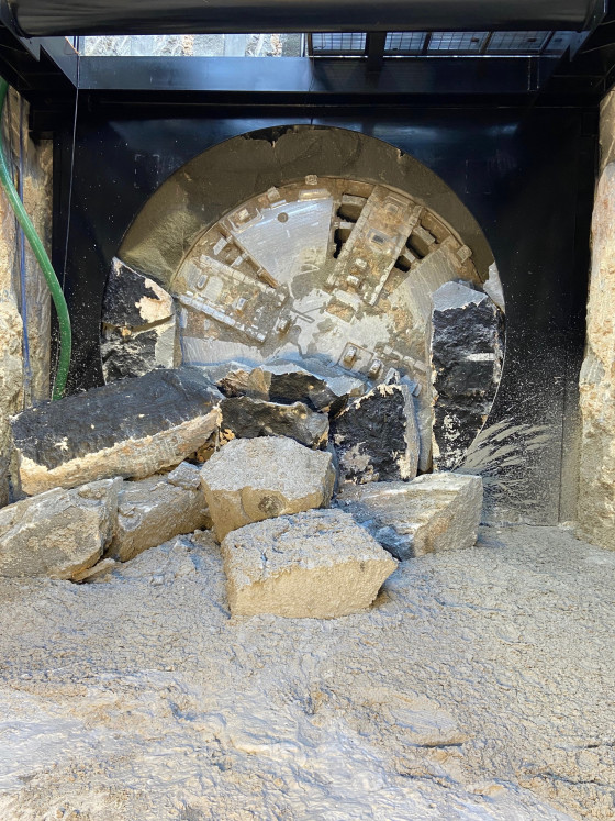Boring machine breaks through marking end of excavation for first tunnel