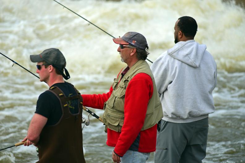 Anglers enjoy the spring steelhead run on the Grand River.