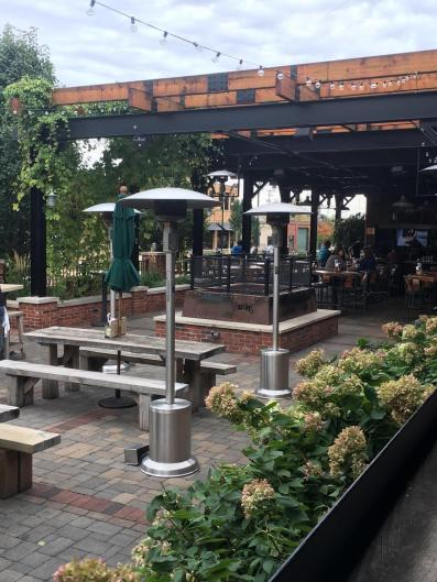 With a patio as big as the restaurant, you can get as close to the fire as you want! Heaters line the patio tables closest to the door.