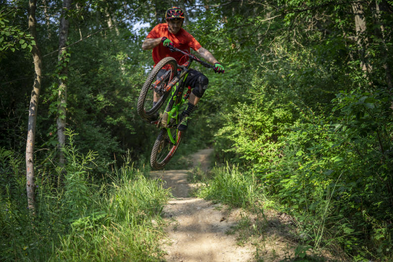 Mountain biker jumping a trail near Grand Rapids
