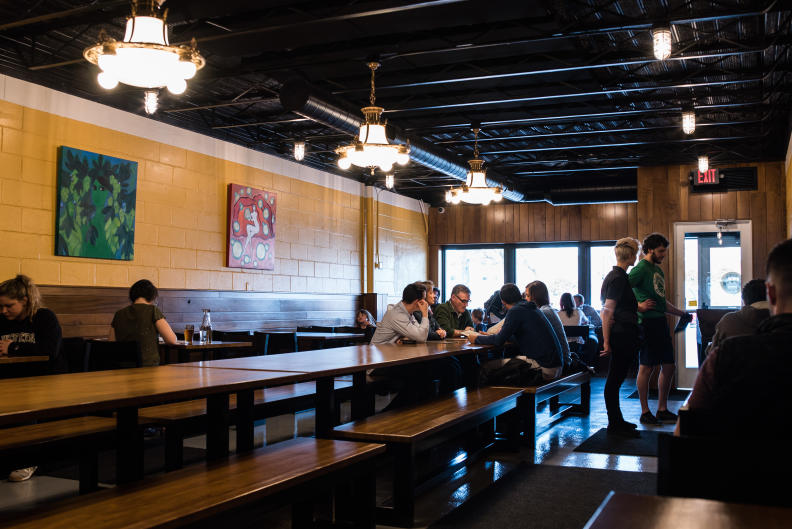 Seating arrangements within Brass Ring Brewing are meant to spark conversation with nearby customers.