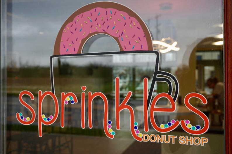 Store front window for Sprinkles Donut Shop in Grand Rapids