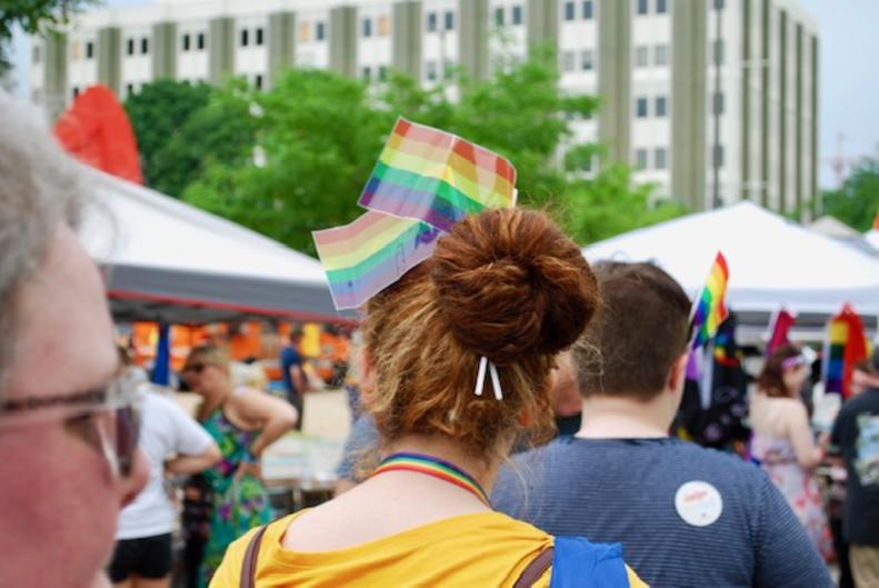 Attendee wearing pride flags in her hair at the Grand Rapids Pride Festival