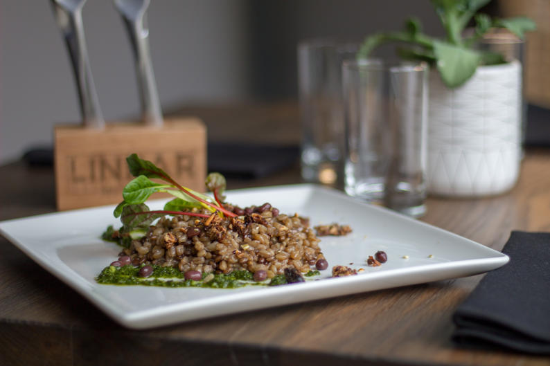 Newly-opened restaurant, Linear, is offering a Chef's Choice option. You can select five courses for $35, including this vegan farro risotto.