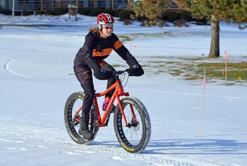 A central District Cyclery team member takes training lap at Indian Trails.