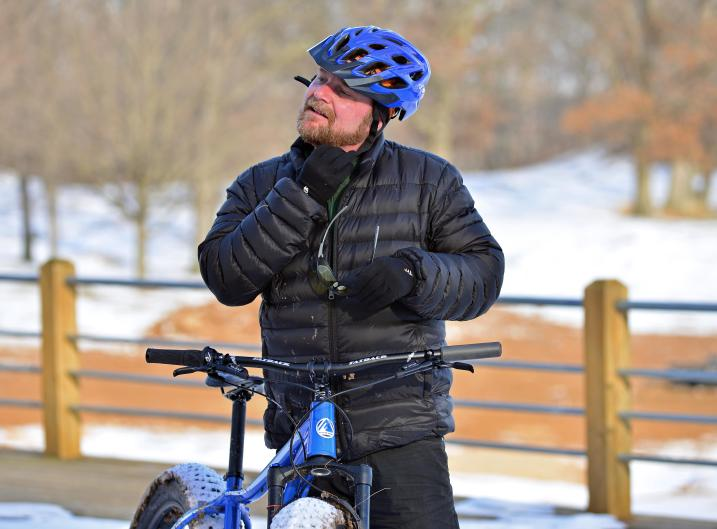 Central District Cyclery owner Nate Phelps pulls his helmet off after at ride at Indian Trails.