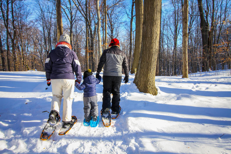 A family snowshoes together at Blandford Nature Preserve.