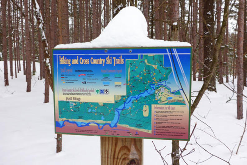 The trail system at Hemlock Crossing Park is well marked. Snowshoers and cross-country skiers share six miles of ungroomed trail, but snowshoers can readily go off-trail and explore.