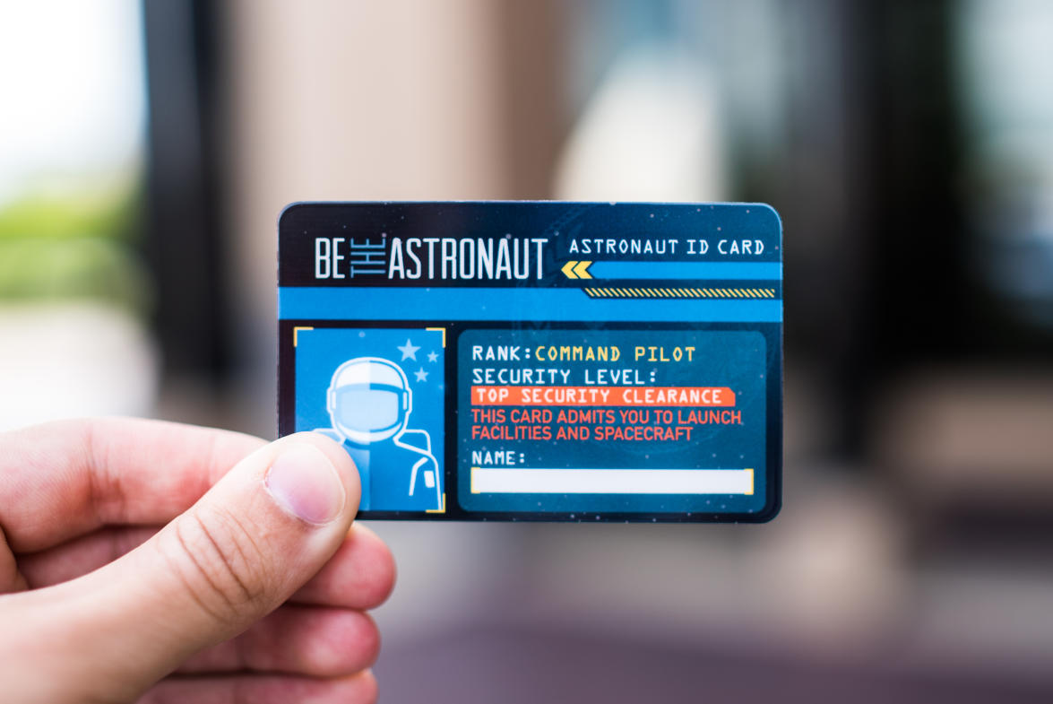 """Step into the Command Pilot role as you experience the Be the Astronaut exhibit with your """"astronaut ID card."""""""