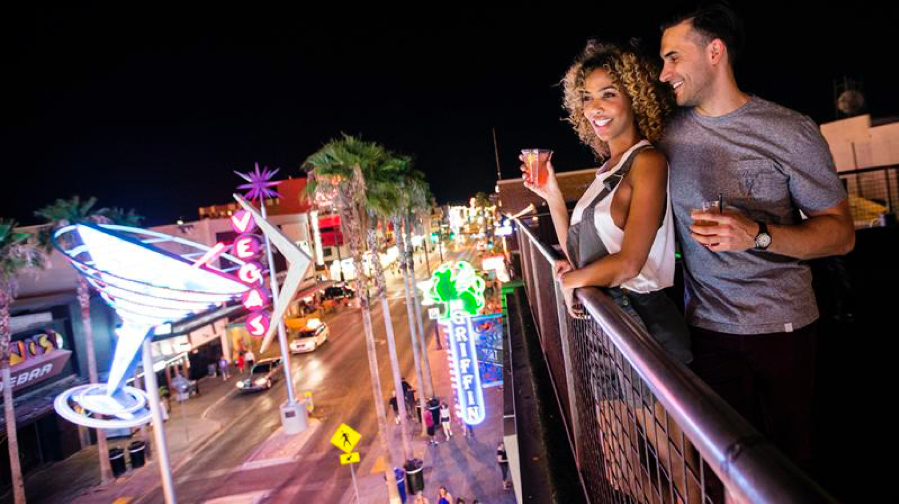 Couple on Fremont street at night